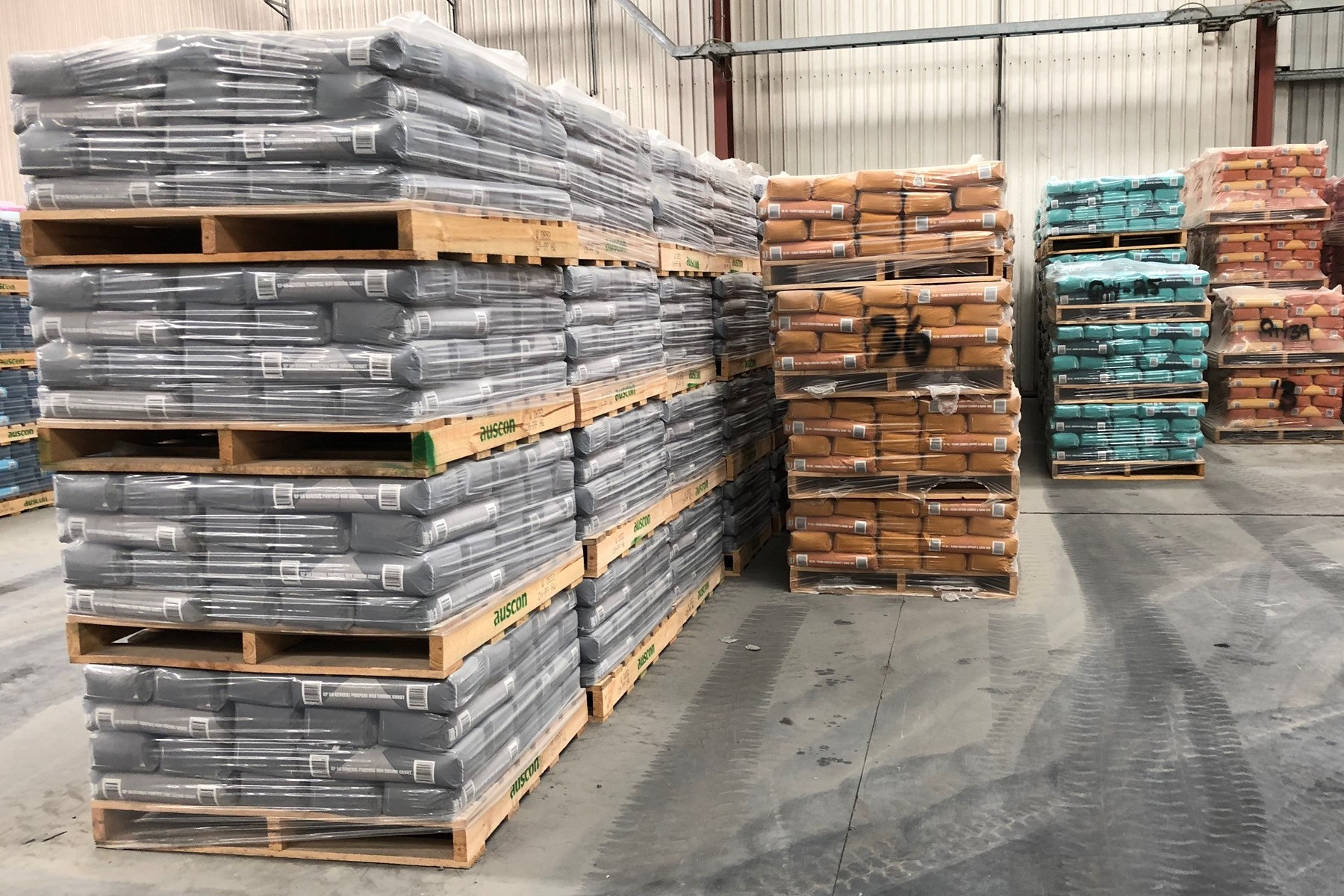 Auscon Australia made cement sitting on pallets in warehouse