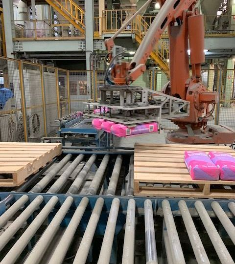 Auscon Australia made cement being packaged and put onto a pallet by a machine