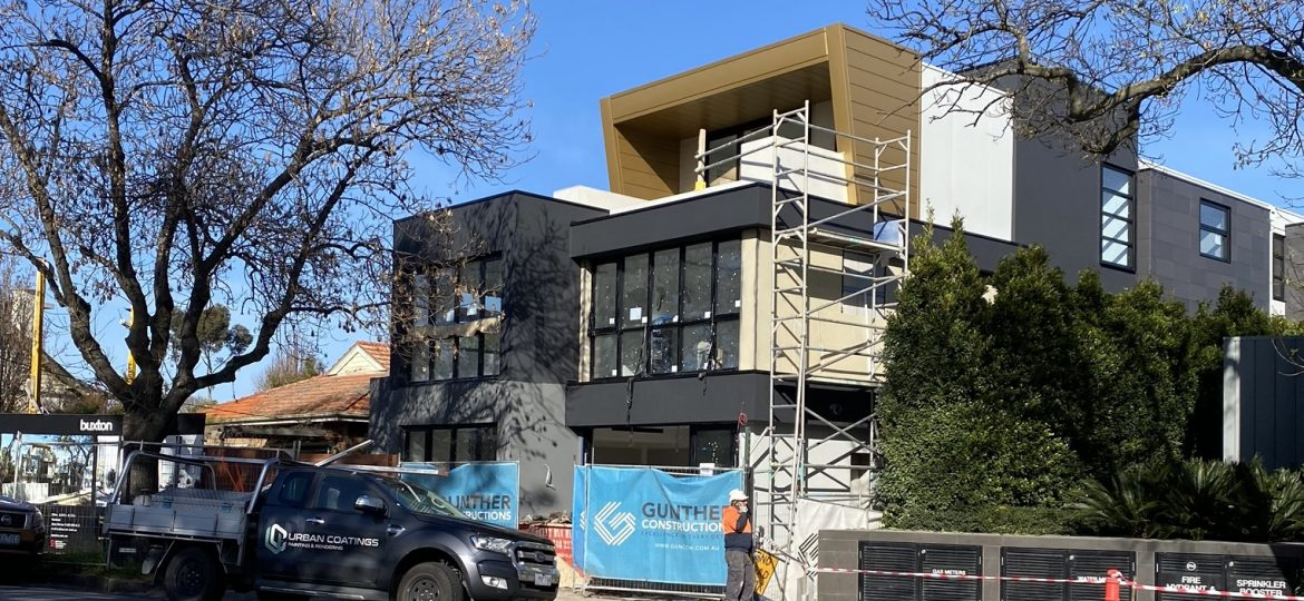 House under construction with non-combustible render being applied